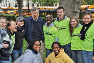 Pitt Chancellor Mark A. Nordenberg jokes with volunteers who gathered that morning.
