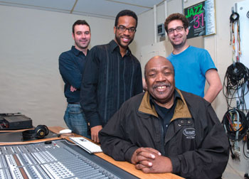 Three Pitt jazz students—the first to be seeking degrees in Pitt's new PhD curriculum in jazz studies—made presentations April 26 in their Advanced Jazz Composition course in Pitt's William R. Robinson Recording Studio in Bellefield Hall. Seated is Nathan Davis, Pitt's director of Jazz Studies, and students (from left) James Moore, Alton Merrell, and Nathan Frink. Each student presented a fully completed score of an extended concert jazz work, a jazz ballet, a jazz musical theater piece or a mini opera, and a score for a film chosen by the composer. Davis developed the new jazz PhD program, which combines musicology, ethnomusicology, composition, and performance.