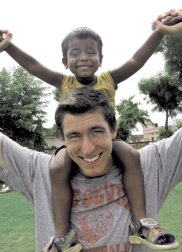 Pitt senior Michael Gowen with one of the children at the orphanage in Jaipur, India.