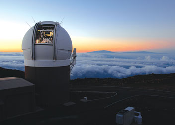 Located atop Hawaii's Haleakala volcano, the Pan-STARRS 1 telescope is the world's most powerful digital camera and includes a refrigerator-sized 1.4 billion-pixel camera that will snap about 500 pictures nightly, each of a swath of sky six times wider than the moon.