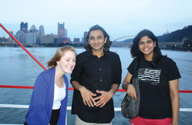 4. Riding the Gateway Clipper were (from left) Elaine Lewis, a Pitt senior majoring in history and political science; and Waqas Khatri of Karachi, Pakistan, and Krithika Sundar of Tamil Nadu, India, both of whom are Penn State graduate students.