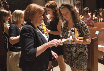 Provost Patricia E. Beeson lights a candle as Freshman women celebrate the 91st annual Lantern Night in Heinz Chapel on Aug. 28. Lantern Night for freshman women is a rite of passage for new students and one of the oldest traditions practiced at the University of Pittsburgh.