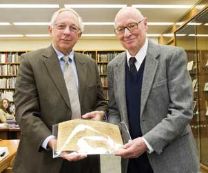 A rare 300-year-old letter written by one of history's most renowned philosophers was recently presented to University Library System (ULS) Director Rush Miller (on left) by Nicholas Rescher, Distinguished University Professor of Philosophy at Pitt and cochair of Pitt's Center for Philosophy of Science. The three-page letter, written in 1711, is the highlight of Rescher's massive collection of materials on philosophy he began donating to ULS last year. The letter was written by theologian Michael Gottlieb Hansch (1683-1749) to G.W. Leibnitz (1646-1716), the celebrated philosopher and mathematician who was an inventor of and contributor to calculus. Hansch was a biographer of German astronomer and astrologer Johannes Kepler (1571-1630). In the letter, Leibnitz asked several questions about Kepler's writings, but also touched upon other, theological matters, including divine justice, infant sin, and freedom of the will. A fourth page of the letter was left blank for Leibnitz's response. Leitnitz wrote back to Hansch, answering his questions and encouraging him to move ahead with publishing Kepler's manuscripts. The rare letter is now housed along with Rescher's other papers in Pitt's Archives of Scientific Philosophy. Rescher, who chaired the philosophy department at Pitt in 1980-81, has authored more than 100 books and hundreds of journal articles on many areas of philosophy.