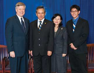 From left, Chancellor Mark A. Nordenberg; Wen-Ta Chiu; his wife, Juan; and their son, Jason, in a photo taken during the 2009 Legacy Laureate dinner at Pitt.
