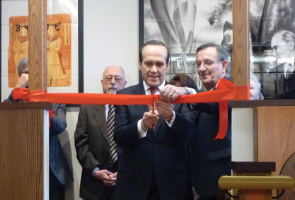 3. Namık Tan, the Turkish ambassador to the United States, cuts the room's ribbon. To his left stands Turkish Room Chair Malik Tunador.