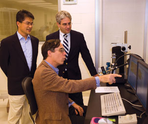 Pitt's David Waldeck (seated) works with Hong Koo Kim (standing left), and David Geller, the Richard L. Simmons Professor of Surgery in Pitt's School of Medicine and codirector of the UPMC Liver Cancer Center. Waldeck's research is focused on finding a way to use nanoparticles to make a commercially viable photovoltaic paint that can convert sunlight into electricity. Waldeck is a professor of chemistry and chair of the Department of Chemistry in the School of Arts and Sciences.
