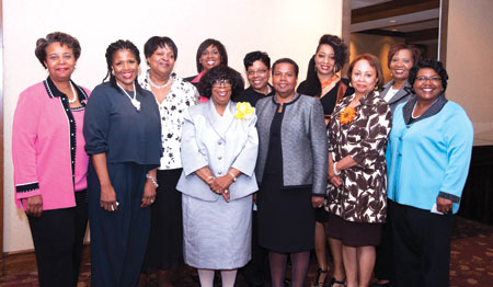 Fifty African American women from Southwestern Pennsylvania have been named Women of Excellence by the New Pittsburgh Courier. The women, selected for making significant contributions to the local community and business world, were honored during a July 14 luncheon at the Westin Convention Center Hotel. Several of the honorees were Pitt alumni, including the following. Front row, from left: Joy Starzl, (SOC WK Certificate of Advanced Studies '97, '97G), Margaret Smith Washington (SOC WK '70G, GSPH '74), Deborah Holland  (A&S '74, EDUC '80G), Marlene Gary Hogan (A&S '73), and Kathy Mayle Towns (NURS '77, '80G, KGSB '82). Back row, from left: Joanne Cobb Burley (EDUC '79G), Jeanette Blackston (SIS '76G, EDUC '96G, ), Amelia Michele Joiner (CGS '98), Emma Lucas-Darby (SOC WK '77G, '86G), Sheila Beasley (CGS '87), and Patricia Wade-Johnson (CGS '87).