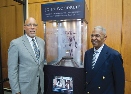 From left, Woodruff Jr. and Hill flank the  interactive display.