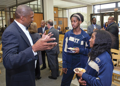 Roger Kingdom (CGS '02), winner of two Olympic gold medals (1984 and 1988) in the 100 meter hurdles, talks with Ashley Corum, Big East champ in the triple jump (left), and Ashley Woodford, who holds Pitt's school record in the 4x100 event.