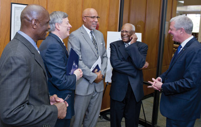From left, Alonzo Webb, head coach of Pitt's Track and Field team; Chancellor Nordenberg; Woodruff Jr.; Pitt trustee Herbert P. Douglas Jr. (EDUC '48, '50G), a bronze medalist in the long jump at the 1948 Olympics; and Steve Pederson, Pitt athletic director.