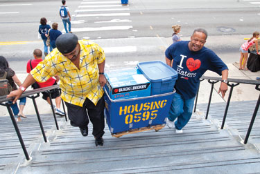 "Parents and volunteers help move students into their residence halls during Pitt's annual ""Arrival Survival."""