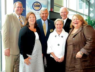 Pitt and sports: The ties that bind the Bigley and Smith families. Front row, from left, Cameron (Smith) Foos (EDUC '03), Joan Bigley, and Georgia Smith (A&S '70); back row, from left: David Foos (KGSB '03), Jack Smith (A&S '69, MED '73), and Tom Bigley (KGSB '56).