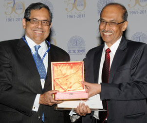 John C. Camillus (left) receives his award from Samir Barua, director of IIM-A.