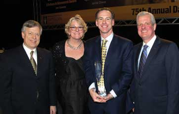 From left: Chancellor Mark A. Nordenberg,  Women's basketball Head Coach Agnus Berenato, Men's basketball Head Coach Jamie Dixon, and Athletics Director Steve Pederson at ceremony celebrating Coach Dixon as the Dapper Dan Sportsman of the Year.