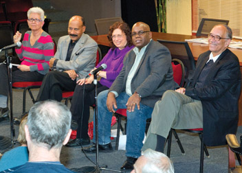 TALKING ABOUT 'RACE': Larry Davis, dean of Pitt's School of Social Work, Donald M. Henderson Professor, and director of the Center on Race and Social Problems at Pitt, and Laurence Glasco, a Pitt history professor, participated in an Oct. 1 community panel discussion about David Mamet's play Race. Performed by the Pittsburgh Irish & Classical Theatre (PICT) in the Stephen Foster Memorial's Henry Heymann Theatre from Sept. 8 through Oct. 1, Race has been described as an incendiary story about perceptions and realities and the subtle shades between being a victim and being victimized. From left, Gale McGloin, panel moderator and PICT development and education director; Davis; Barbara Wolvovitz, a civil rights attorney; Tony Norman, Pittsburgh Post-Gazette columnist and associate editor; and Glasco.