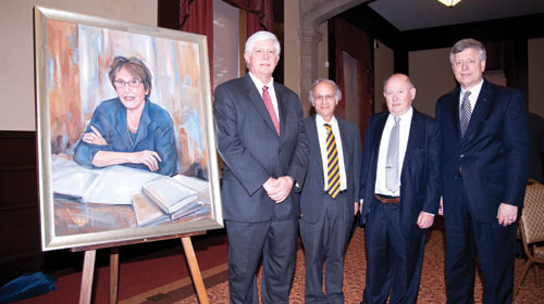 HONORING KATHERINE M. DETRE: A portrait of the late Katherine M. Detre, one of the nation's leading epidemiologists, was unveiled during a June 9 reception in the University Club. At the time of her death in January 2006, Detre was a Distinguished Professor of Epidemiology in Pitt's Graduate School of Public Health. During her career, she led groundbreaking large-scale studies on the effects of cholesterol-lowering drugs on coronary artery disease and cardiovascular risk factors in women, among other topics. From left are Donald S. Burke, GSPH dean; Arthur S. Levine, senior vice chancellor for the schools of the health sciences and dean of the School of Medicine; Lewis H. Kuller, Distinguished University Professor of Public Health; and Pitt Chancellor Mark A. Nordenberg. The portrait, which will be displayed in GSPH's lobby in Parran Hall, was a gift to the school from two of Detre's close friends.