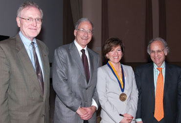 "Ellen Frank (third from left), Distinguished Professor of Psychiatry in Pitt's School of Medicine, delivered an April 6 talk, ""Relieving the Burden of Mood Disorders: A Three-Decade Journey,"" as part of the Provost's Inaugural Lecture Series. Following the lecture in the Frick Fine Arts Auditorium, Frank was joined by (from left), Pitt Provost and Senior Vice Chancellor James V. Maher; David J. Kupfer, the Thomas Detre Professor of Psychiatry and Frank's husband; and Arthur S. Levine, senior vice chancellor, Health Sciences, and dean of the University of Pittsburgh School of Medicine."