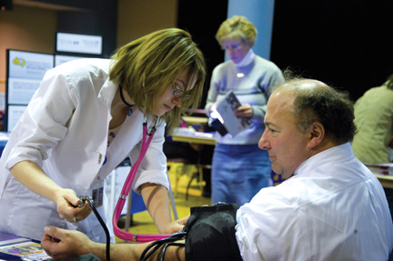 Spring Into a Healthy Lifestyle was the theme of an April 14 health fair sponsored by Pitt's Staff Association Council in the William Pitt Union. Vendors included Venture Outdoors, the University benefits department, Falk Pharmacy, the Central Blood Bank, and others. Above, John Kozar, Pitt director of benefits, has his blood pressure taken during the fair.