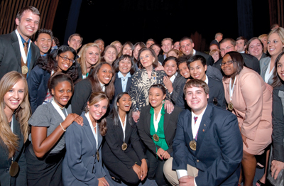 Frances Hesselbein, second row, center, surrounded by a group of international students leaders.