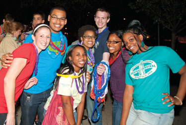Tropical leis and hula dancing drew students to a nighttime luau outside the William Pitt Union on Aug. 26.