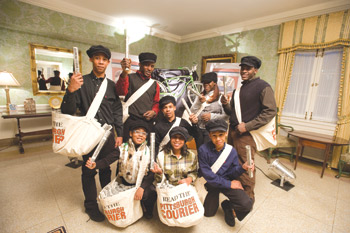 Newsboys (and girls) added to the evening's ambience by delivering free Courier newspaper facsimile programs. Front row, from left: Anwara Tayloradams, Lana Macklin, and Keanu Davis. Back row, from left: Naeem Davis, David Humphrey, Amani Davis, Alexis Dixon, and Daniel Humphrey.