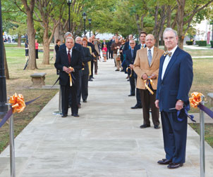 Pitt's ODK honorees, along with several Pitt administrators, stand on the rededicated ODK walkway between Heinz Chapel and the Cathedral of Learning.