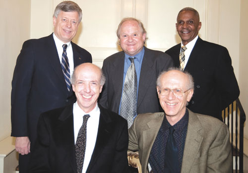 Jonathan and Peter Salk (seated, from left), two of Jonas Salk's sons, who came to the screening from California; Chancellor Nordenberg; Kurlander; and Vice Chancellor Hill (standing, from left).