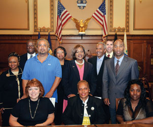 Five members of the Pittsburgh Citizen Police Review Board (CPRB), including Pitt's Deborah Walker and Debora Whitfield (seated, center and left, respectively), took their oaths of office on Sept. 10 in City Council's chambers. Walker (CGS '01, GSPIA '03), a former Pitt police officer, is the student conduct officer and assistant to the dean in Pitt's Office of Student Affairs. Whitfield (CGS '06) is a financial counselor in Pitt's School of Dental Medicine. Several Pitt administrators and colleagues observed the ceremony. From left, Carol Mohammed, director of Pitt's Office of Affirmative Action, Diversity, and Inclusion; James N. Williams III, assistant director, City/County Relations, Pitt Governmental Relations; Richard M. Carrington, CPRB member; Gwen Watkins, vice president, Steering Committee, Pitt Staff Association Council; Pitt Vice Provost and Dean of Students Kathy W. Humphrey; Vice Chancellor for Public Affairs Robert Hill; Shawn E. Brooks, associate dean and director, Pitt Residence Life; Eugene M. Downing Jr., CPRB member; and, seated at right, Leshonda Roberts, CPRB member.