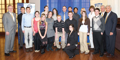 Pitt's scholar-athletes with perfect 4.0 grade point averages (GPAs) gathered during the University's March 4 Scholar-Athlete Awards Breakfast in Alumni Hall. The two women kneeling in front are Lauren Zammerilla (left) and Chrissy Colalillo. Second row, beginning from left with student in blue shirt, Zachary Mueller, Sarah Looney, Erin Meehan, Jonathan Buchanan, Philip Konieczny, Victoria Toso, and Justin Boehm. Back row, beginning with Provost and Senior Vice Chancellor James V. Maher on far left, Aaron Hassett, Meagan Dooley, Lauren Hartman, William (B.J.) Conklyn, Scott McKillop, Mycaiah Clemons, Healther Lezanic, Andrew Kalas, Pitt Athletic Director Steve Pederson, and Pitt Alumni Association President-elect Jack Smith.