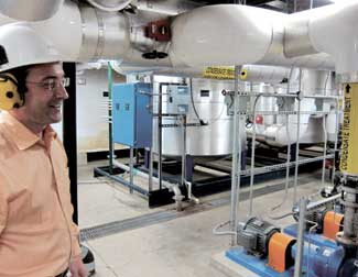 Above: Carrillo Street Steam Plant manager Marian Gagu stands before rows of industrial purifiers that monitor and control the pH balance of water heading into the boilers.