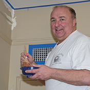 John Kozar, Pitt assistant vice chancellor for human resources, paints at Oakland's Family House residence facility for patients and their families.