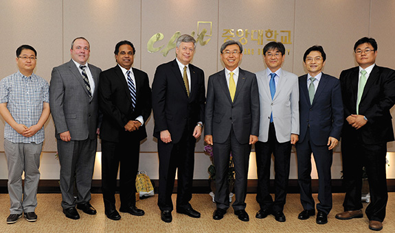 Pitt's Korea delegation stands with Chung-Ang University's President Lee and three top university officials, including one Pitt alumnus. From left, Pitt's Jeong; Kane; Shroff; and Chancellor Nordenberg; Chung-Ang University's President Lee; Yun Gyeon-Hyeon, vice president for natural sciences and engineering; Hong Jun Hyun (GSPIA '95), dean of international affairs; and Lee Dong-Hyun, professor of integrative engineering.