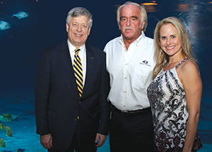 Chancellor Mark A. Nordenberg (left) with Gregory and Jennifer Bossart. Alumnus Gregory Bossart —chief veterinary officer and senior vice president of Veterinary Services at the Georgia Aquarium—hosted the Chancellor along with Pitt Alumni Association leaders, members, and staff at the University on the Road reception.