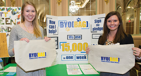 Liza Boulet (left) and Jessica McDonald, both graduating environmental studies majors at Pitt, created BYO[BAG], a program intended to reduce plastic bag usage on Pitt's campus. The program gives each student a 15-bag quota per semester, with usage tracked via a computer system. Once students reach their quota, the bags cost 25 cents each. There has been more than a 70 percent reduction in plastic-bag use on campus since the program began Feb. 3, from 15,000 plastic bags a week to about 4,000 plastic bags.
