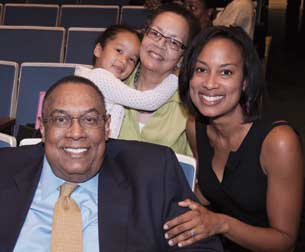 From left, Dean Emeritus Epperson; 4-year-old granddaughter, Morgan; his wife, Cecelia Trower Epperson; and daughter, Lia Beth Epperson, a professor in American University's Washington College of Law.